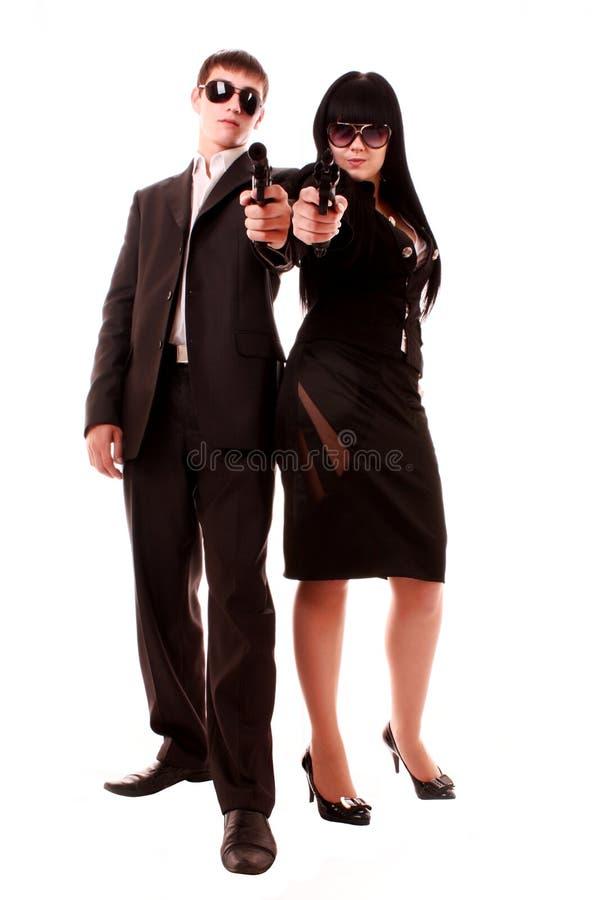 Homem e mulher com os injetores no estilo do negócio imagens de stock