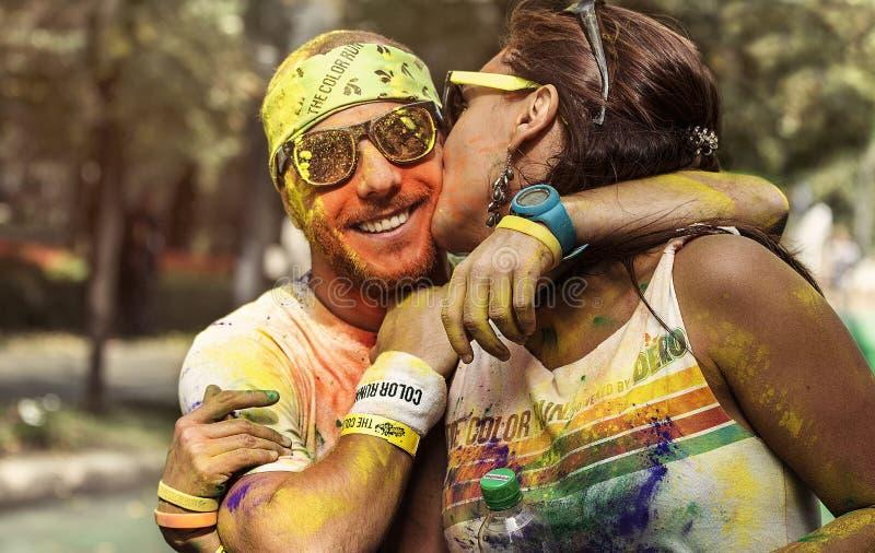 Homem e mulher na corrida Bucareste da cor foto de stock