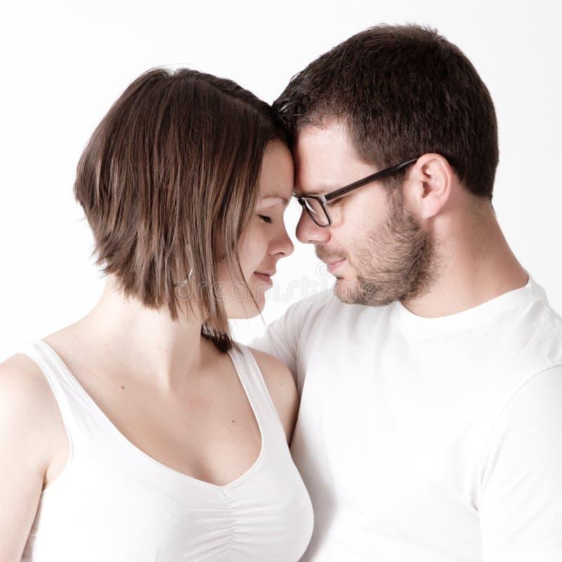Homem e mulher no toque do amor imagem de stock