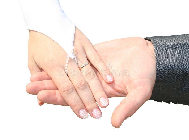 Homem e mulher suas mãos do casamento foto de stock