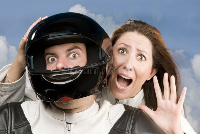 Homem e mulher temível em uma motocicleta imagens de stock royalty free