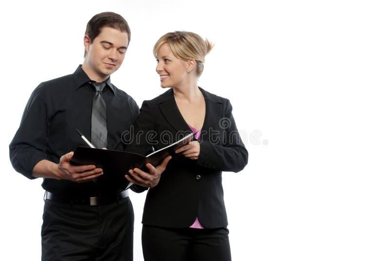 Homem e mulheres de negócio imagem de stock