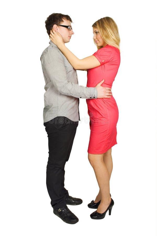 Homem e posição e abraço da menina imagem de stock