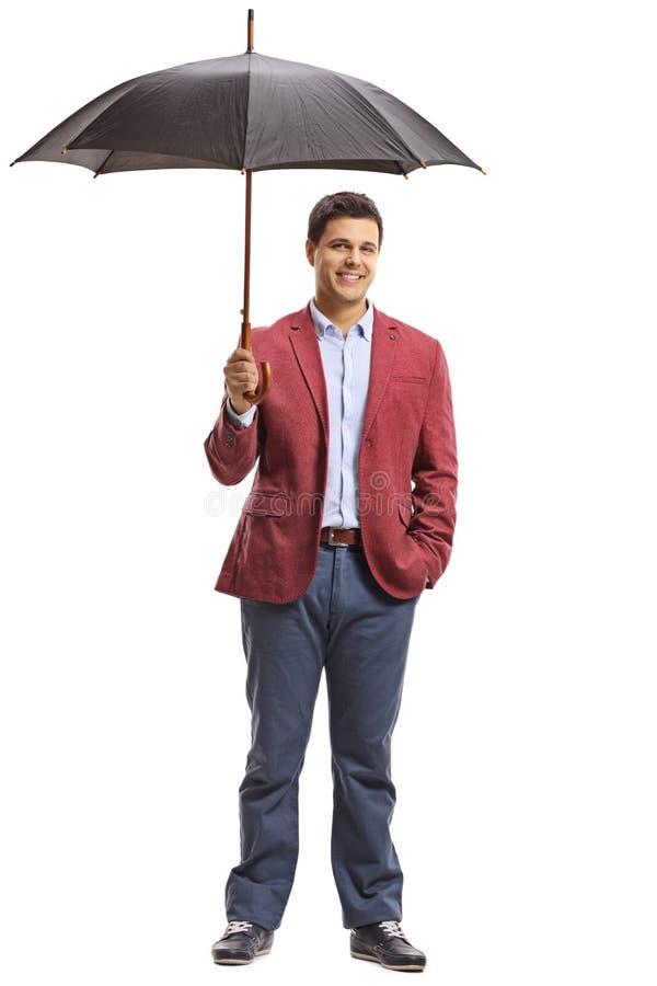 Homem elegantemente vestido com um guarda-chuva fotos de stock