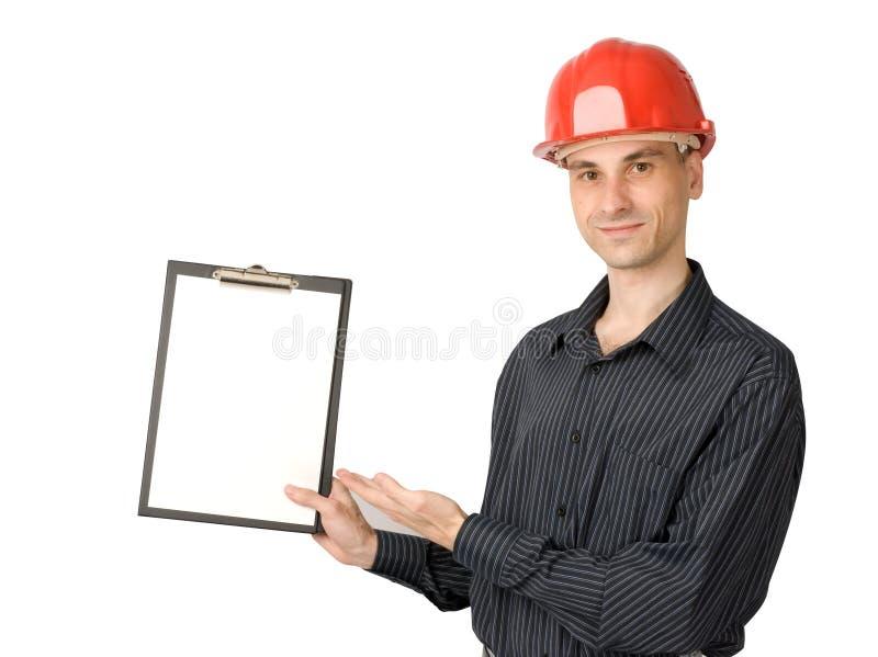 Homem em um capacete vermelho do edifício fotos de stock royalty free