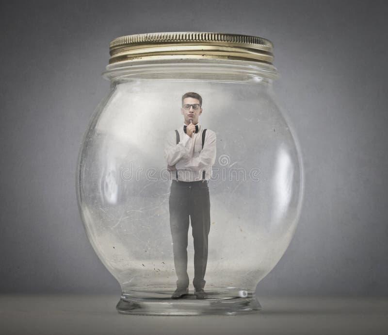 Homem em um vidro imagem de stock