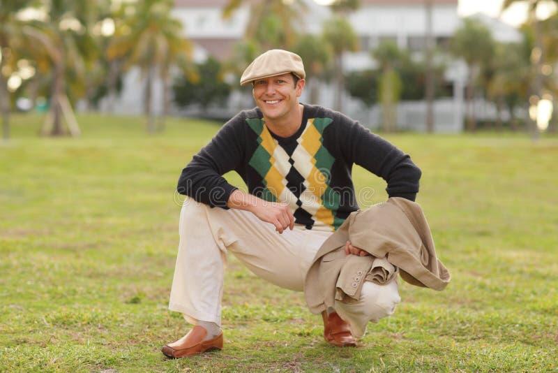 Homem em uma camisola do argyle imagem de stock royalty free