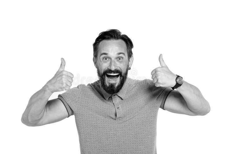 Homem emocional com os dois polegares isolados acima no fundo branco Indivíduo emocional farpado entusiasmado com cara feliz Pole fotografia de stock