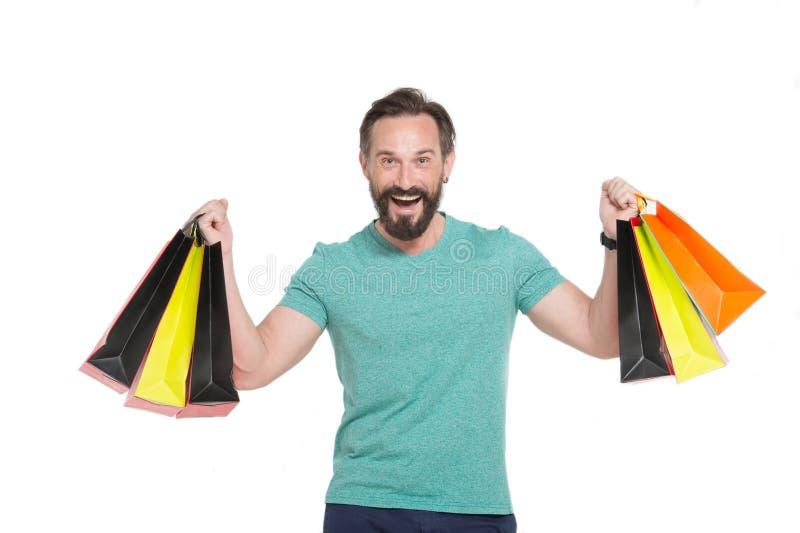 Homem entusiasmado que sorri após ter tido a compra produtiva imagem de stock royalty free