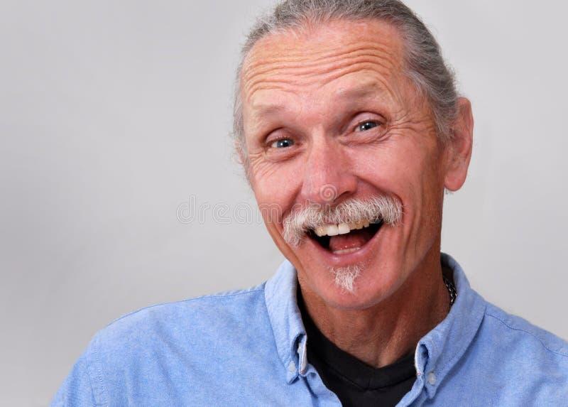 Homem envelhecido médio exuberante foto de stock