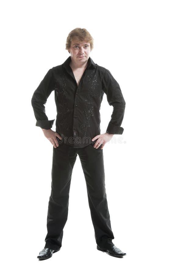 Homem envelhecido meio no pano preto imagens de stock royalty free