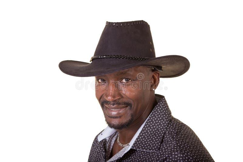 Homem envelhecido meio que veste um chapéu de vaqueiro foto de stock royalty free
