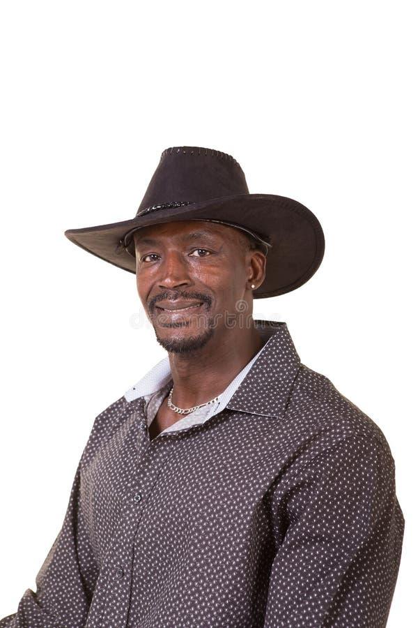 Homem envelhecido meio que veste um chapéu de vaqueiro imagens de stock