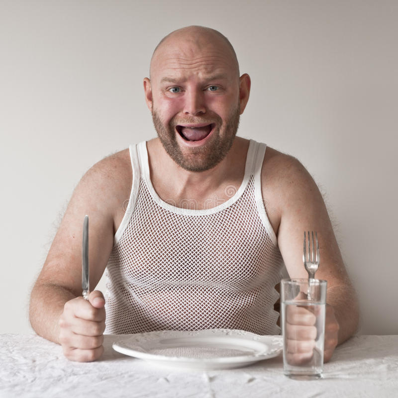 Homem estranho e com fome imagem de stock