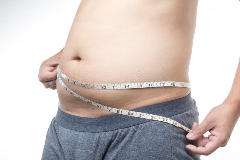 Homem excesso de peso com fita métrica em torno da cintura imagens de stock