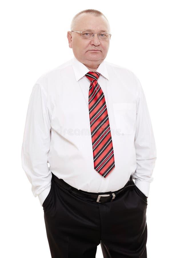 Homem executivo com mãos em uns bolsos imagens de stock royalty free
