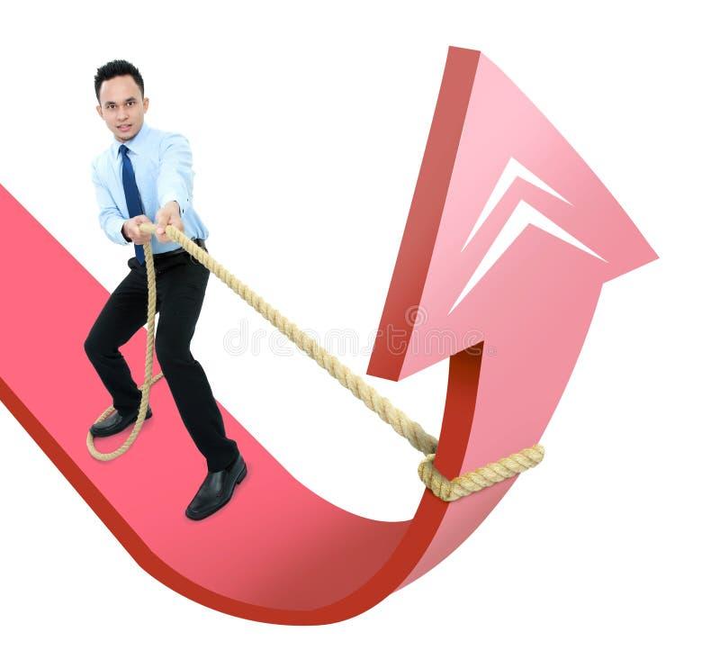 Homem executivo masculino que puxa para cima uma seta fotografia de stock