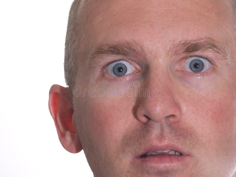 Homem Eyed azul espantado imagens de stock