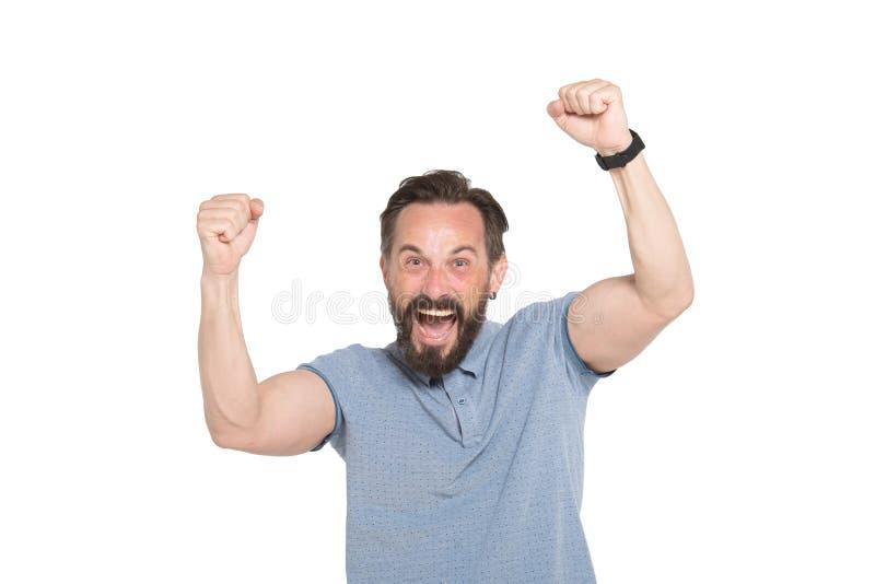 Homem farpado entusiasmado que aumenta seus punhos acima fotografia de stock