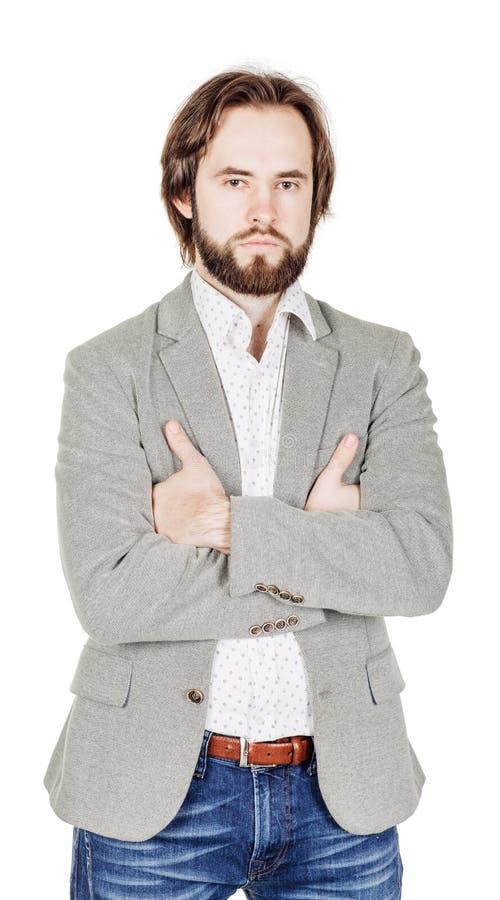 Homem farpado que olha a câmera e que mantém os braços cruzados e humano fotografia de stock royalty free