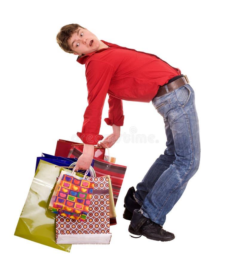 Homem feliz engraçado alegre da compra. imagens de stock