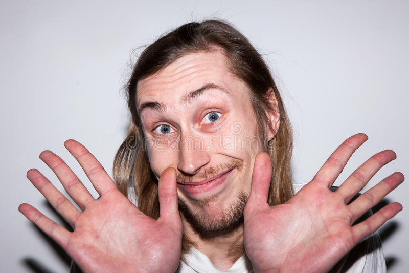 Homem feliz inocente Negue a participação foto de stock
