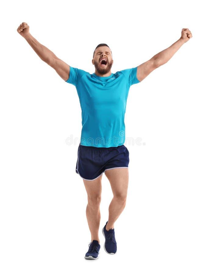 Homem feliz novo no corredor do sportswear fotos de stock royalty free