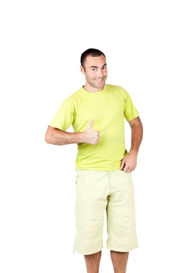 Homem feliz que dá lhe os polegares acima foto de stock royalty free