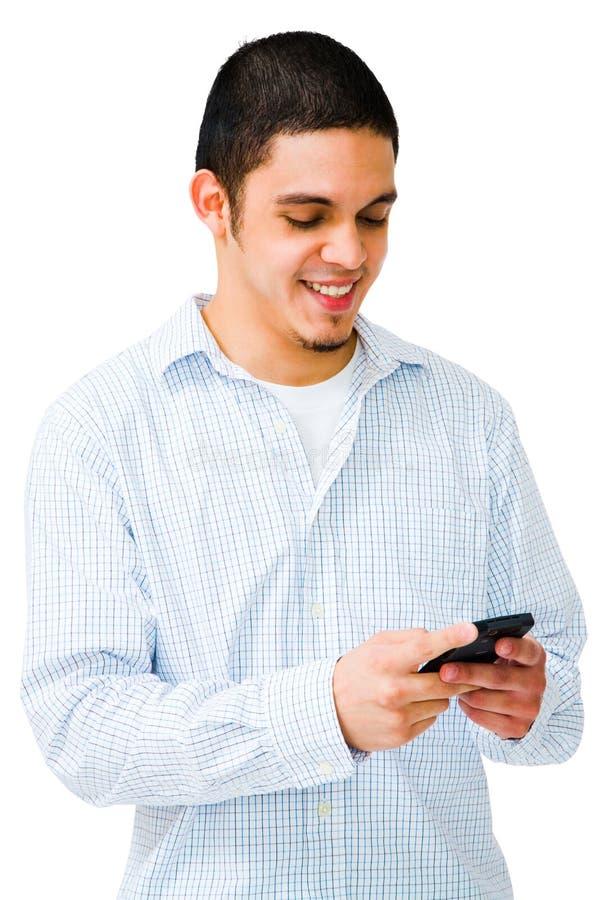 Homem feliz que usa o telefone móvel foto de stock