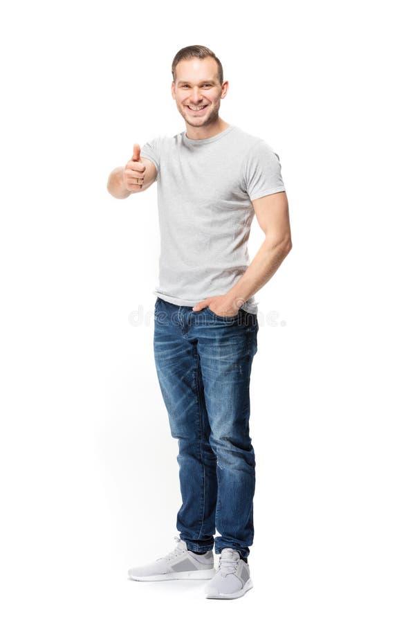 Homem feliz seguro que mostra o gesto APROVADO foto de stock royalty free