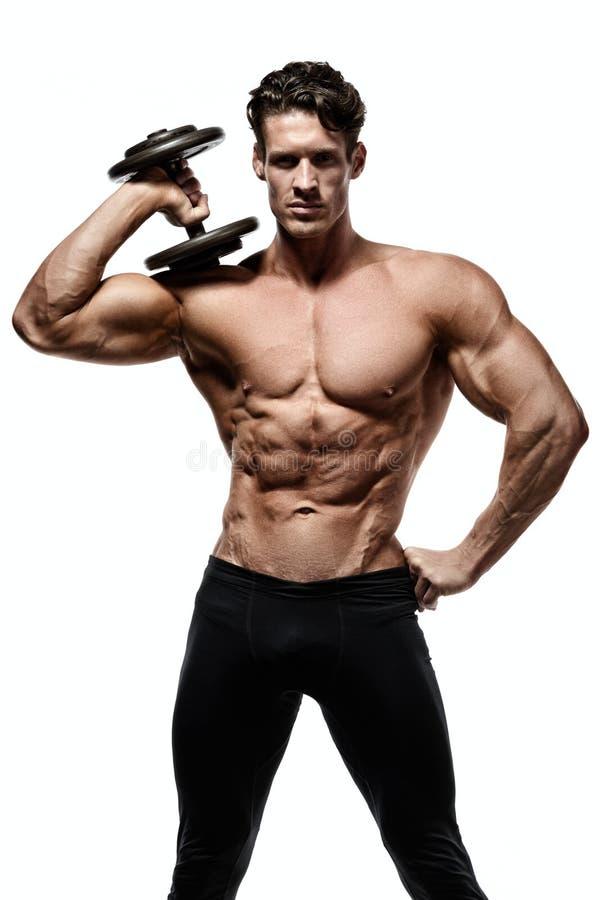 Homem forte com Abs, os ombros, o bíceps, o tríceps e a caixa perfeitos fotografia de stock royalty free