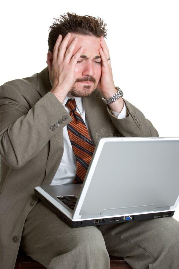 Homem frustrante do portátil foto de stock royalty free