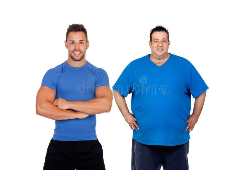 Homem gordo e seu treinador prontos para treinar imagens de stock