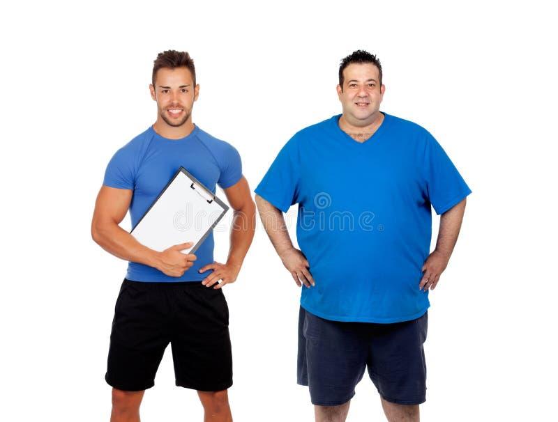 Homem gordo e seu treinador prontos para treinar foto de stock royalty free
