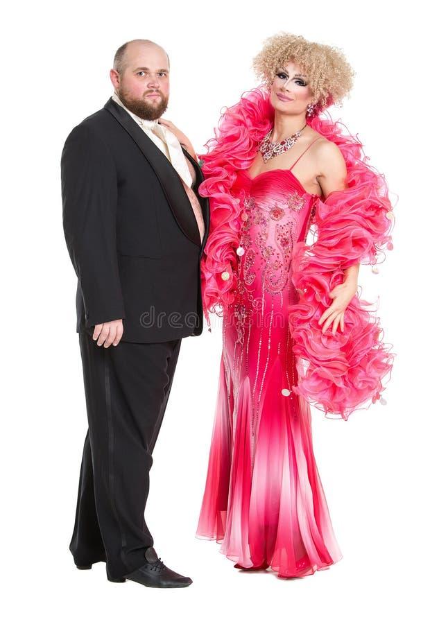 Homem gordo excêntrico em um smoking e em uma senhora bonita em uma noite D fotos de stock royalty free
