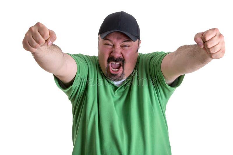 Homem gritando feliz que aumenta os braços após Team Wins imagem de stock royalty free