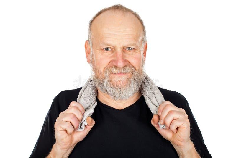 Homem idoso após a sessão do gym imagens de stock