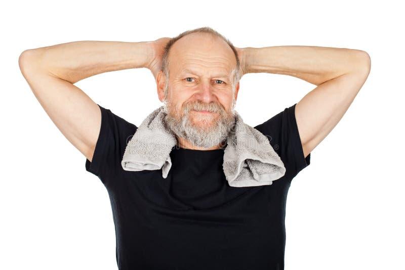 Homem idoso após a sessão do gym foto de stock royalty free