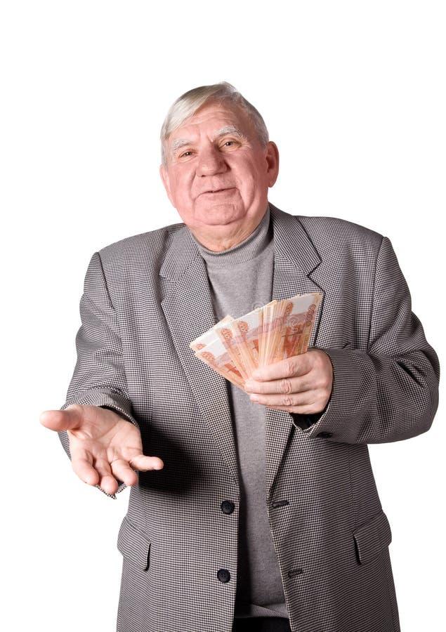 Homem idoso com dinheiro nas mãos imagem de stock