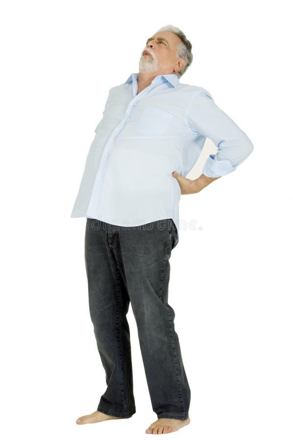 Homem idoso com dor traseira imagem de stock