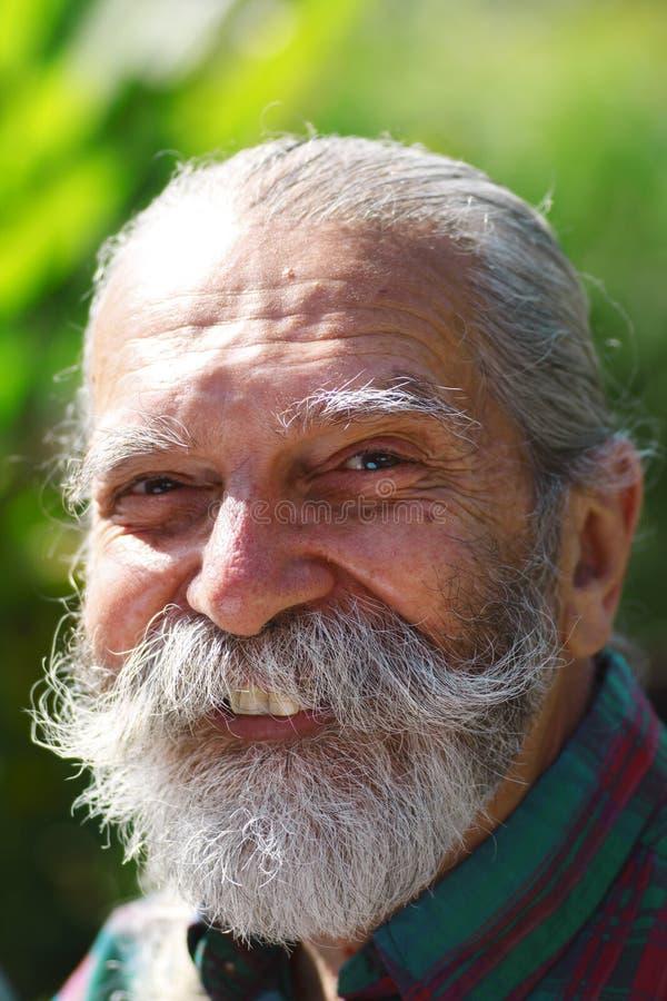 Homem idoso com uma barba imagem de stock royalty free