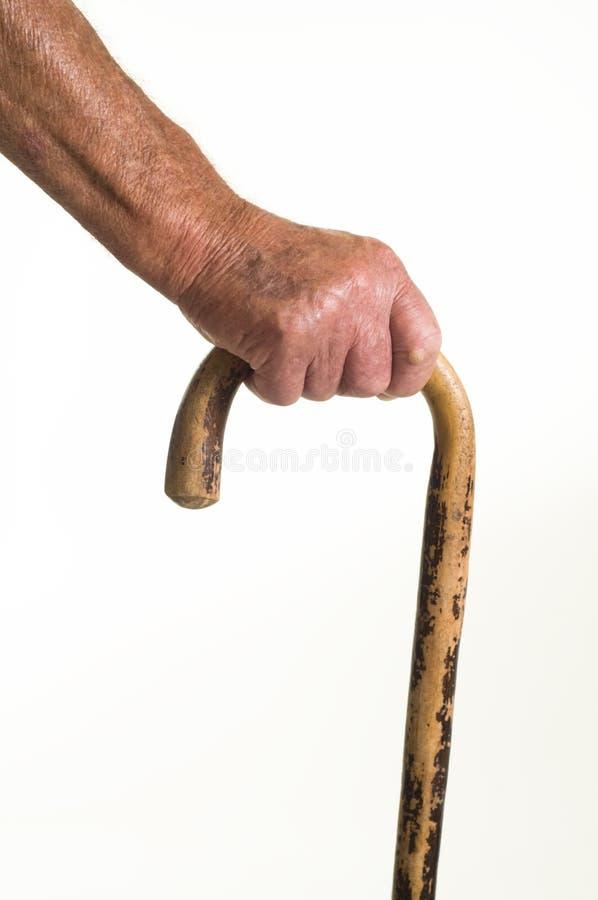 Homem idoso e vara de passeio fotos de stock royalty free
