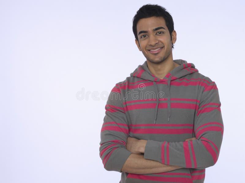Homem indiano novo de sorriso fotografia de stock