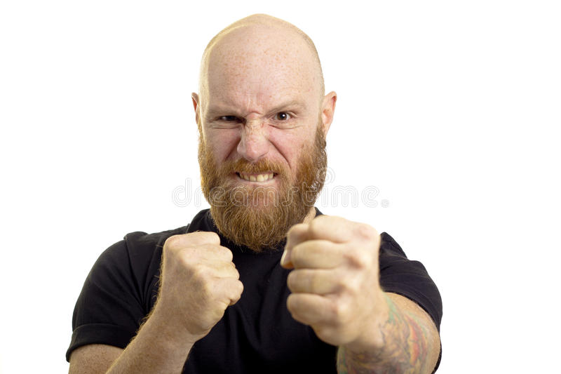 Homem irritado na posição de combate fotografia de stock