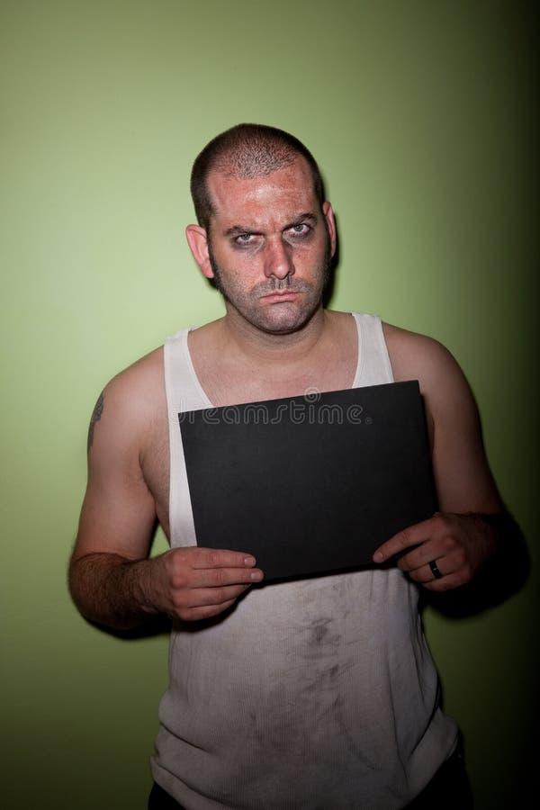 Homem irritado no mugshot fotografia de stock royalty free