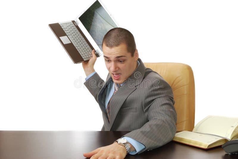 Homem irritado no trabalho fotografia de stock
