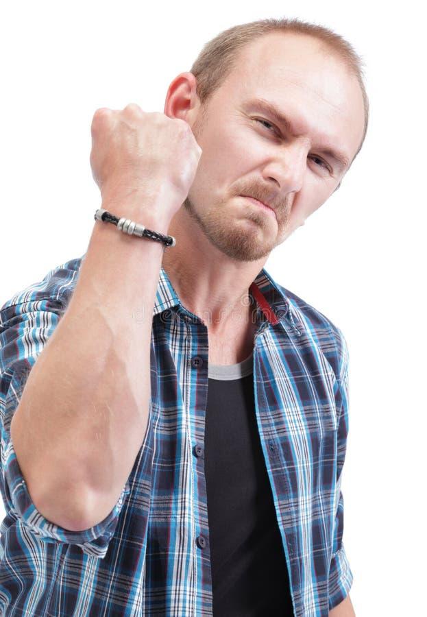 Homem irritado que mostra o punho imagem de stock royalty free