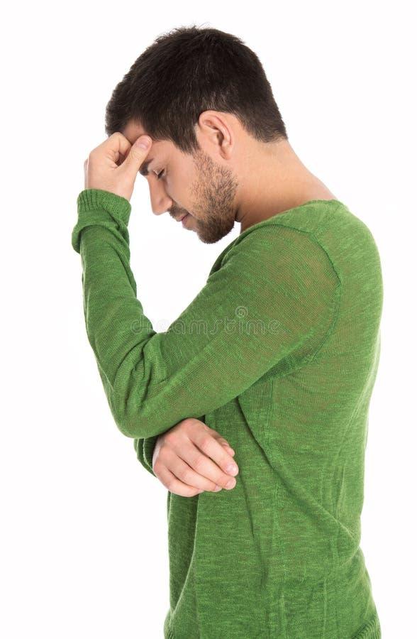 Homem isolado pensativo ou depressivo no pulôver verde fotografia de stock royalty free