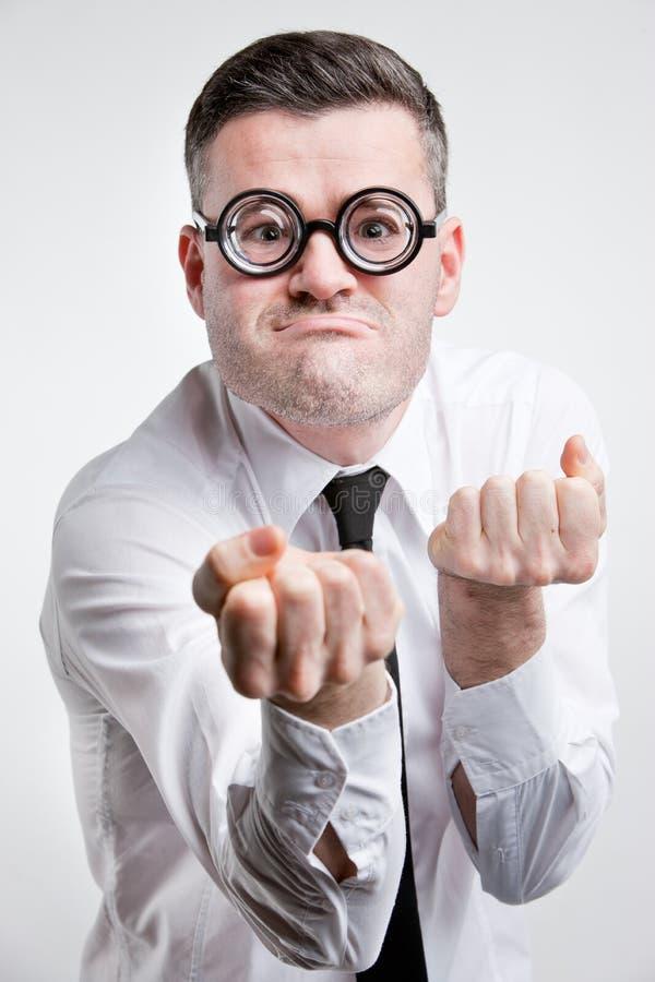 Homem jinxy do nery estranho pronto para lutar foto de stock royalty free