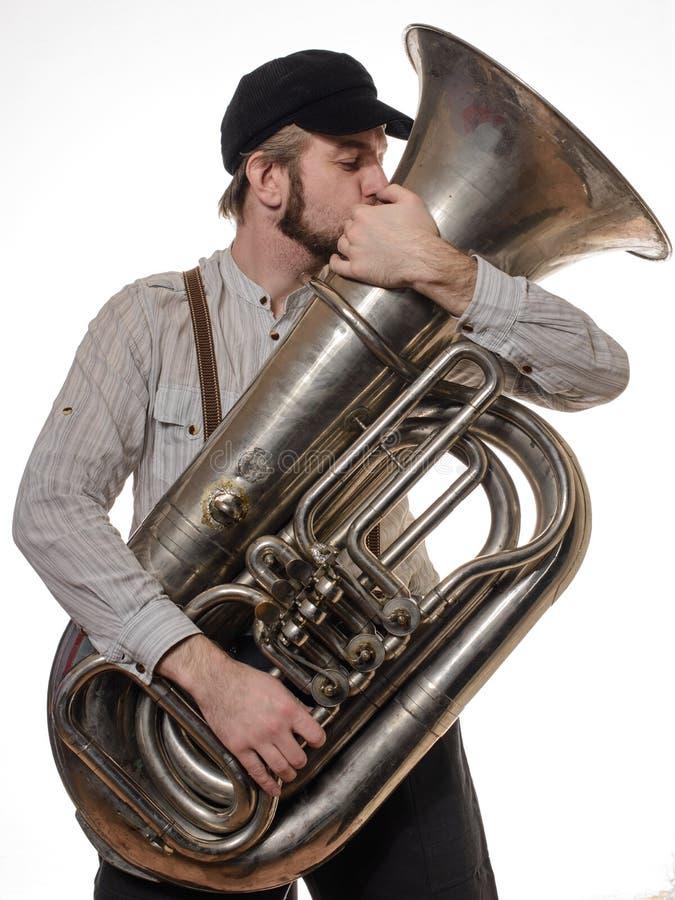 Homem loving com suspensórios e beijos do tubo do tampão foto de stock